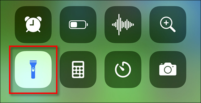 turn off the flashlight by tapping on flash icon in control center