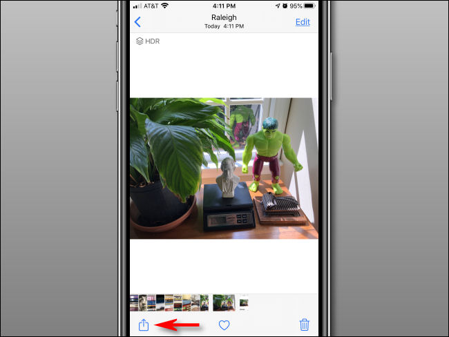 tap on the share button of the photo on iPhone or iPad